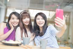 Happy woman friends in restaurant Royalty Free Stock Photography