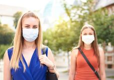 Free Woman Friends Walking With Face Mask After Lockdown Reopening - New Normal Friendship Concept With Girls Spending Time Together On Royalty Free Stock Image - 193858986
