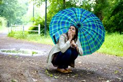 Woman frightened by the storm Royalty Free Stock Images