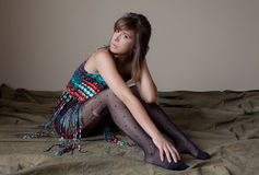 Woman in Fringe Top and Stockings Royalty Free Stock Image