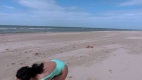 Woman with Frisbee disc on the beach stock video footage