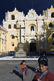 Woman in fron of La Merced Church. Women and children selling souvenirs to tourists in front of La Merced Church in Antigua royalty free stock photos