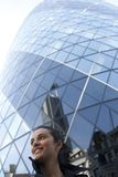 Woman in front of 30 St Mary Axe in London Royalty Free Stock Photography