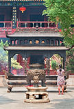 Woman in front of an altar at White Cloud Temple Bai Yun Guan Beijing. Stock Photography