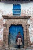 Woman in front of ancient door Moray Cuzco Peru Royalty Free Stock Photos