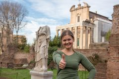 Woman in front of antique romanian sculpture stock photo