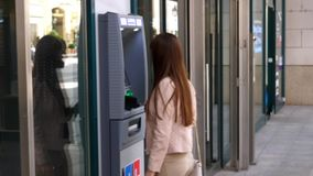 Woman in front of ATM machine