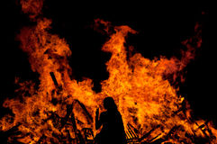 Woman in front of a big fire Royalty Free Stock Photography