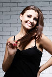 Woman in front of brick wall Royalty Free Stock Image