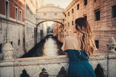 Woman in front of Bridge of Sighs in Venice Royalty Free Stock Images