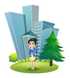 A woman in front of the building Royalty Free Stock Photography