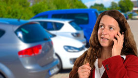 Woman in front of cars Stock Image