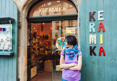 Woman in front of ceramics shop Stock Photo