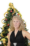 Woman in front of Christmas tree Royalty Free Stock Photo