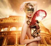 Woman in front of Colosseum Royalty Free Stock Images