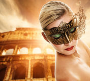 Woman in front of Colosseum Stock Photography