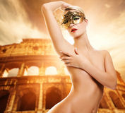 Woman in front of Colosseum Royalty Free Stock Photo