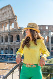 Woman in front of colosseum in rome, italy Stock Photography