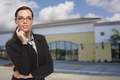 Woman In Front of Commercial Building Stock Images