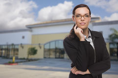 Woman In Front of Commercial Building Stock Photo