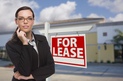 Woman In Front of Commercial Building and For Lease Sign Stock Photos