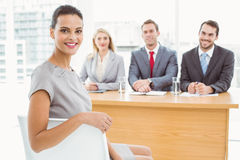 Woman in front of corporate personnel officers. Portrait of women sitting in front of corporate personnel officers in office stock photography