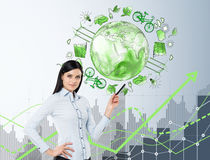 Woman in front of eco energy icons, clean environment Royalty Free Stock Photos