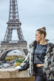 Woman in front of Eiffel tower in Paris, France looking aside Royalty Free Stock Photos