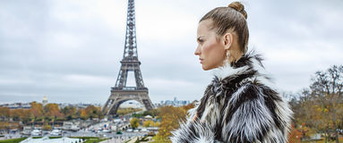 Woman in front of Eiffel tower in Paris looking into distance Royalty Free Stock Photo