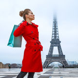 Woman in front of Eiffel tower in Paris with shopping bag Stock Image