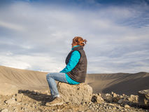 Woman in front of an empty volcanic crater in Iceland Royalty Free Stock Photo