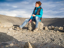 Woman in front of an empty volcanic crater in Iceland Royalty Free Stock Images