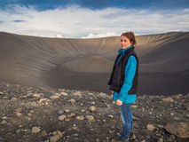 Woman in front of an empty volcanic crater in Iceland royalty free stock photos