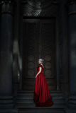 Woman in front of a fairy-tale door. Stock Photography