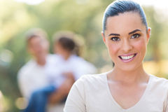 Woman in front family Stock Image