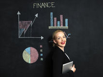 Woman in front finance concept on chalkboard stock photography