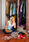 Woman in front of full closet stock images