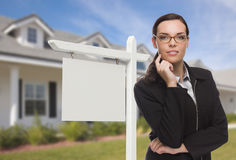 Woman In Front Of House and Blank Real Estate Sign Stock Images