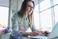 Woman in front of laptop stock images