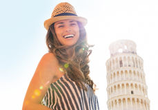 Woman in front of leaning tower of pisa, tuscany Royalty Free Stock Images
