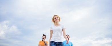 Woman in front of men feel confident. Moving forward support male team. What makes successful female leader. Girl leader royalty free stock image