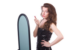 The woman in front of mirror Royalty Free Stock Image