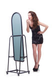 The woman in front of mirror Stock Photos