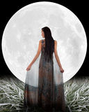 Woman in front of a Moon. Elements of this image furnished by NASA Stock Images