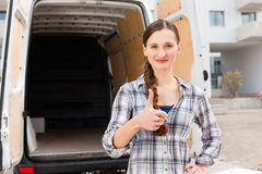 Woman in front of moving truck royalty free stock photo