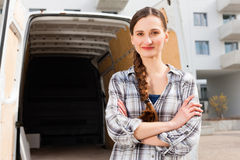Woman in front of moving truck stock photo
