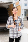 Woman in front of moving truck Royalty Free Stock Images