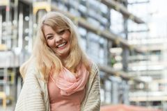 Woman on front of new house building Stock Image