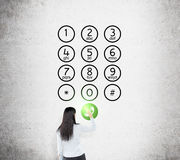 Woman in front of number buttons Stock Photos