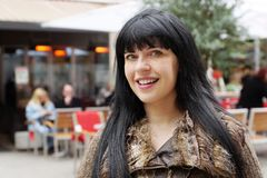 Woman in front of an outdoor cafe Royalty Free Stock Photo